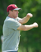 Washington Redskins head coach Jay Gruden loosens-up as his team participates in warm-up drills during an organized team activity (OTA) at Redskins Park in Ashburn, Virginia on Wednesday, May 25, 2015.<br /> Credit: Ron Sachs / CNP