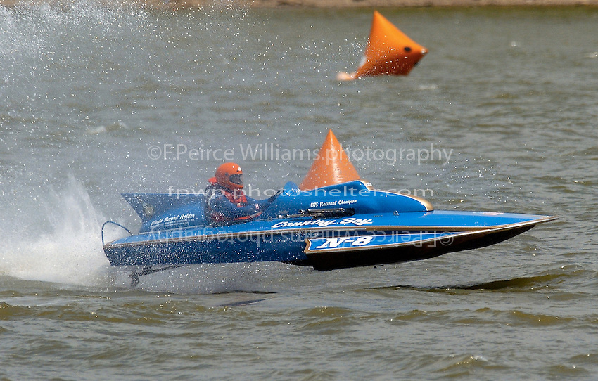 "The vintage Lauterbach built 225 inboard hydroplane ""Country Boy"" drives through the slop of Madison's turn 2. This is the boat that former Miss Budweiser driver Jim Kropfeld (1982-1989) drove to a National Championship in 1975 thereby making a name for himself..Tom & Jac Bertolini, N-8 ""Country Boy"", 1971 Lauterbach 225 class hydroplane..2004 Madison Regatta, Madison, Indiana, July 4, 2004"