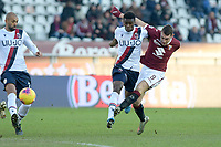 12th January 2020; Olympic Grande Torino Stadium, Turin, Piedmont, Italy; Serie A Football, Torino versus Bologna; Andrea Belotti of Torino FC has a shot at goal as Ibrahima Mbaye of Bologna FC  challenges - Editorial Use