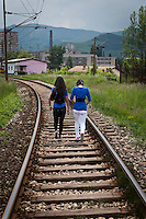 The Sualic family have to walk across the tracks for getting into the city. They make several such trips a day.