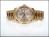BNPS.co.uk (01202 558833)<br /> Pic: SheffieldAuctionGallery/BNPS<br /> <br /> ***Please use full byline***<br /> <br /> Rolex; An 18ct Rose Gold Oyster Perpetual Day-Date Diamond Set Gent's Wristwatch<br /> <br /> A &pound;110,000 haul of jewellery seized from the ringleader of a &pound;26million tobacco smuggling operation is to go under the hammer.<br /> <br /> The collection includes a luxurious 9-carat diamond ring valued at &pound;40,000 and four jewel-encrusted designer wristwatches collectively worth &pound;30,000.<br /> <br /> Also among the 30 lots are an &pound;8,000 4.5 carat single stone ring, large 7-carat ear studs worth &pound;15,000 and a bizarre solid gold baby's dummy worth &pound;500.<br /> <br /> The items were confiscated from Daniel Harty, the mastermind of a criminal gang jailed for smuggling 150 million cigarettes and two tonnes of low quality tobacco into the UK.<br /> <br /> Harty created a distribution network around the north of England transporting cigarettes to warehouses, storage yards and farms.<br /> <br /> Between them they evaded paying &pound;26million of duty.<br /> <br /> Harty, 30, from Doncaster, Yorks, was jailed in June last year for four and a half years after pleading guilty to conspiracy to evade excise duty.<br /> <br /> The jewellery was seized from Harty on his arrest in early 2011 under the Proceeds of Crime Act. A judge ordered it should be sold to satisfy a &pound;330,000 confiscation order.<br /> <br /> The auction is being held at Sheffield Auction Gallery on March 21.