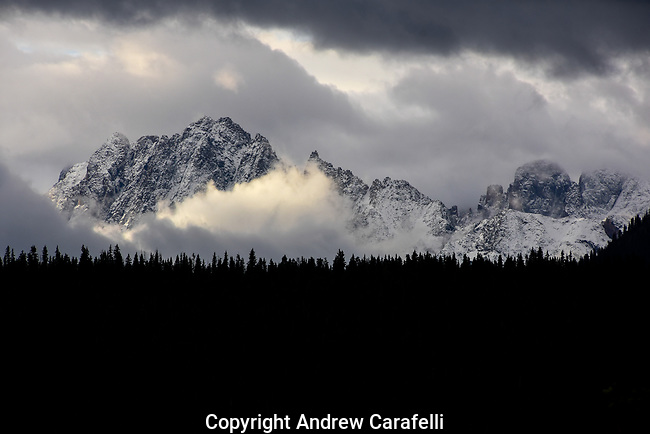 Roiling clouds race past the Needle Mountains, a sub-range of the San Juan Mountains, in Southwest Colorado.