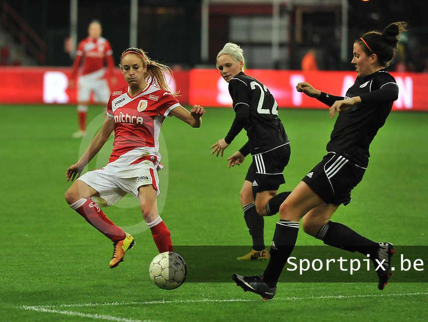 20131009 - LIEGE , BELGIUM : Standard's Tessa Wullaert (left) pictured with Glasgow Leanne Crichton (right) during the female soccer match between STANDARD Femina de Liege and  GLASGOW City LFC , in the 1/16 final ( round of 32 ) first leg in the UEFA Women's Champions League 2013 in stade maurice dufrasne - Sclessin in Liege. Wednesday 9 October 2013. PHOTO DAVID CATRY