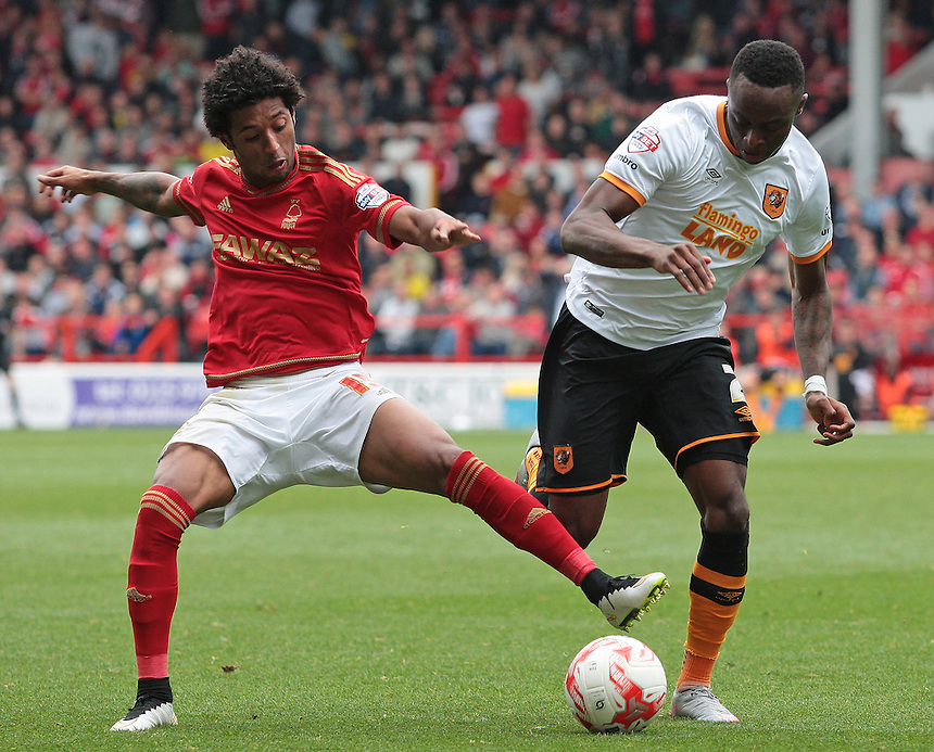 Nottingham Forest's Kyle Ebecilio vies for possession with Hull City's Moses Odubajo<br /> <br /> Photographer David Shipman/CameraSport<br /> <br /> Football - The Football League Sky Bet Championship - Nottingham Forest v Hull City - Saturday 3rd October 2015 - The City Ground - Nottingham<br /> <br /> &copy; CameraSport - 43 Linden Ave. Countesthorpe. Leicester. England. LE8 5PG - Tel: +44 (0) 116 277 4147 - admin@camerasport.com - www.camerasport.com