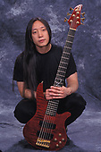 POMPANO BEACH FL - MARCH 04: John Myung of Dream Theater poses for a portrait at The Pompano Beach Amphitheater on March 4, 2000 in Pompano Beach, Florida. Photo by Larry Marano © 2000