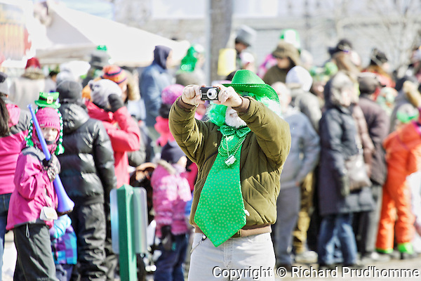 An avid photographer dressed in green for Rawdon's St. Patrick's parade