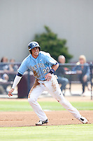 Kris Bryant #23 of the University of San Diego Toreros leads off of first base during a game against the Loyola Marymount Lions at Page Stadium on April 5, 2013 in Los Angeles, California. (Larry Goren/Four Seam Images)