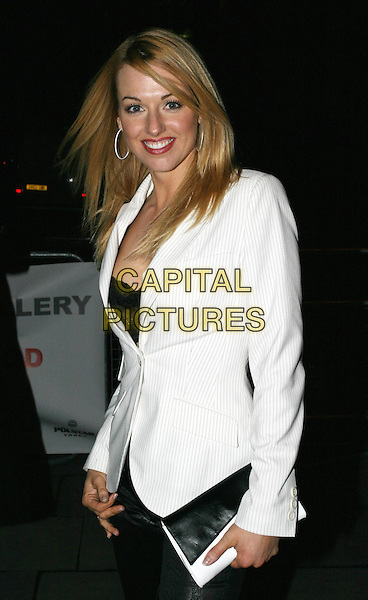 SARAH MANNERS.The Saatchi Gallery's first anniversary party at County Hall which coincides with the launch of new exhibition New Blood.23 March 2004.half length, half-length, white blazer.www.capitalpictures.com.sales@capitalpictures.com.© Capital Pictures.