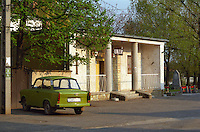 "In the Tokaj village Mad: a bar / café with a sign advertising ""Unicum"" the very typical Hungarian alcohol and a classic Trabant car. Mad is one of the main villages in the Tokaj district.  Credit Per Karlsson BKWine.com"