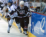 February 4, 2010:  Team USA's Natalie Darwitz (20) in action during the Quest Tour Pre Olympic Exhibition match between Finland and Team USA women's ice hockey at the World Arena, Colorado Springs, Colorado.  Team USA defeats Finland 5-1.