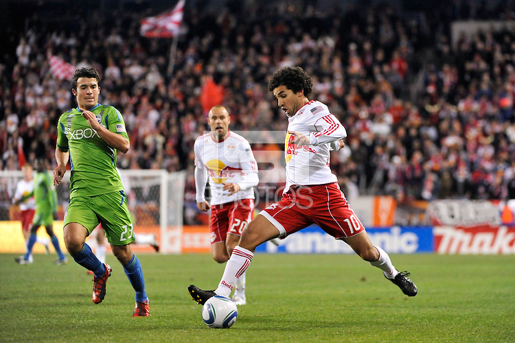 Mehdi Ballouchy (10) of the New York Red Bulls plays the ball as Servando Carrasco (23) of the Seattle Sounders defends. The New York Red Bulls defeated the Seattle Sounders 1-0 during a Major League Soccer (MLS) match at Red Bull Arena in Harrison, NJ, on March 19, 2011.