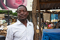 Man selling chickens in Dambwa Central Market, Livingstone, Zambia