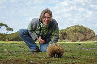 Elyn Stubblefield viewing a Short-beaked Echidna (Tachyglossus aculeatus multiaculeatus) foraging at the Flinders Chase National Park on Kangaroo Island, South Australia, Australia.