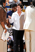 28 January 2012:  FIU Head Coach Cindy Russo speaks with assistants before addressing her players during a time out in the first half as the FIU Golden Panthers defeated the Western Kentucky University Hilltoppers, 60-56, at the U.S. Century Bank Arena in Miami, Florida.