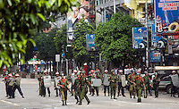 An army patrol in downtown Yangon. Following a series of demonstrations in the preceding days calling for the overthrow of the country's military junta, the streets were relatively quiet, with constant army and police patrols preventing further large scale protests.