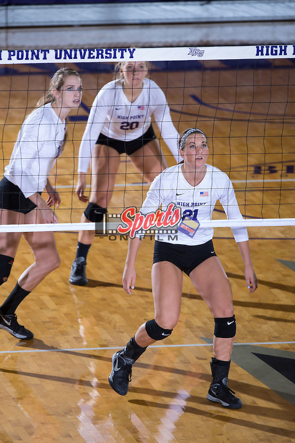 Camryn Freiberg (21), Haley Barnes (20) and Savannah Angel (10) await a serve during the match against the Wake Forest Demon Deacons at the Panther Invitational at the Millis Athletic Center on September 12, 2015 in High Point, North Carolina.  The Demon Deacons defeated the Panthers 3-1.   (Brian Westerholt/Sports On Film)