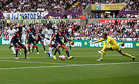 Pictured: Bafetimbi Gomis of Swansea takes a shot, Tim Krul of Newcastle saves the ball Saturday 15 August 2015<br />