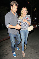 Diane Kruger spotted leaving a romantic dinner with boyfriend Joshua Jackson in Santa Monica. Diane is wearing a cigarette cut jeans, blue and white striped navy look sweater, an ivory quilted Chanel chain strap bag and lace up booties. Even her red nail polish is matching the heart shaped patch on her shirt! Los Angeles, California on 5.6.2012..Credit: Correa/face to face.. /MediaPunch Inc. ***FOR USA ONLY***