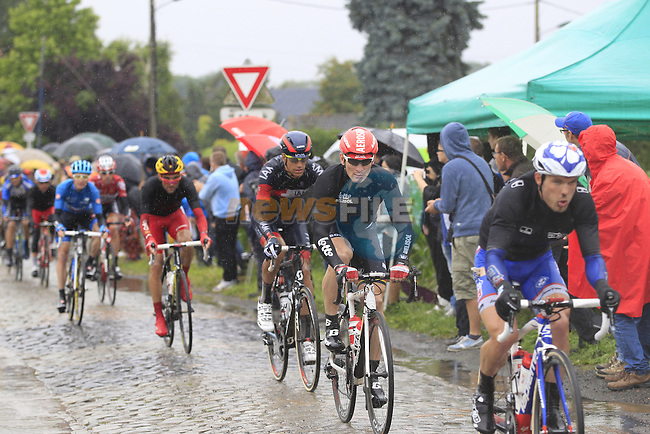 Riders including Andre Greipel (GER) Lotto-Belisol tackle the1st cobbled sector 9 from Gruson to Crossroads de l'Arbe during Stage 5 of the 2014 Tour de France running 155.5km from Ypres to Arenberg. 9th July 2014.<br /> Picture: Eoin Clarke www.newsfile.ie