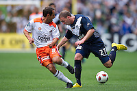MELBOURNE, AUSTRALIA - SEPTEMBER 12, 2010: Geoff Kellaway from the Victory fights with Massimo Murdocca from the Roar for the ball in Round 6 of the 2010 A-League between the Melbourne Victory and Brisbane Roar at AAMI Park on September 12, 2010 in Melbourne, Australia. (Photo by Sydney Low / Asterisk Images)