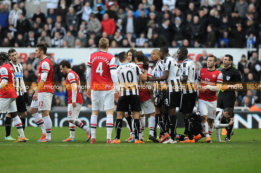 Both sets of players clash - Newcastle United vs Arsenal - Barclays Premier League Football at St James Park, Newcastle upon Tyne - 29/12/13 - MANDATORY CREDIT: Steven White/TGSPHOTO - Self billing applies where appropriate - 0845 094 6026 - contact@tgsphoto.co.uk - NO UNPAID USE
