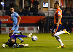 Picture by David Horn/eXtreme Aperture Photography +44 7545 970036<br /> 26/11/2013<br /> Andre Gray of Luton Town beats Danny Hurst of Southport to the ball but puts his shot wide during the Skrill Premier match at Kenilworth Road, Luton.