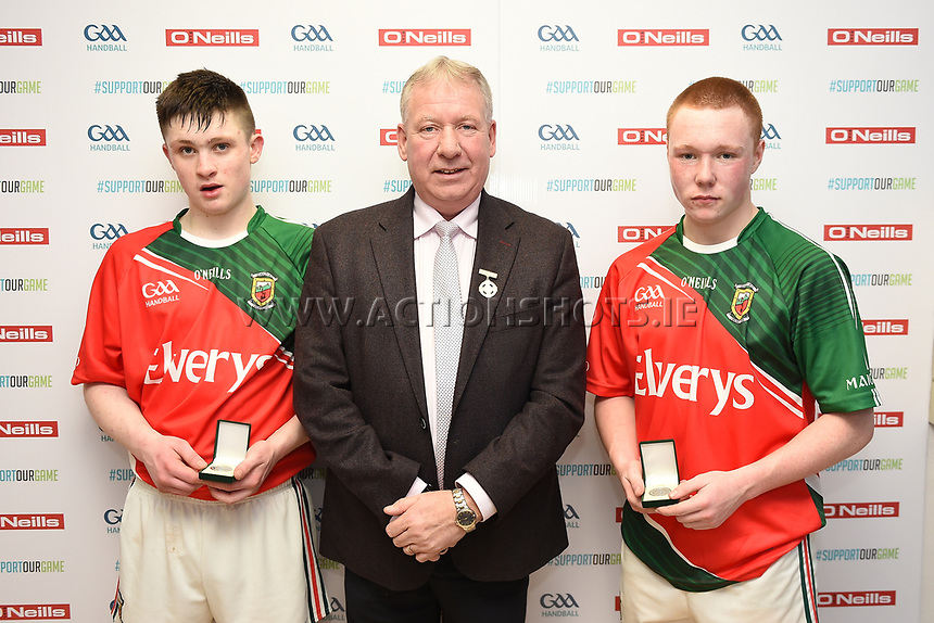 19/03/2018; 40x20 All Ireland Juvenile Championships Finals 2018; Kingscourt, Co Cavan;<br /> Boys Under-17 Doubles; Mayo (Alan Masterson/Patrick Carroll) v Cork (Luke Barrett/Colin Healy)<br /> Runners up Alan Masterson/Patrick Carroll with GAA Handball President Joe Masterson<br /> Photo Credit: actionshots.ie/Tommy Grealy