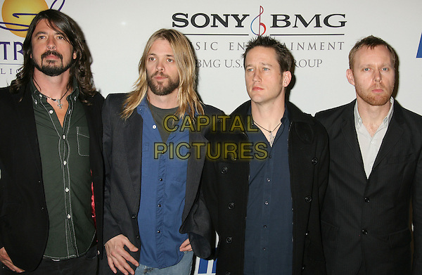 DAVE GROHL, TAYLOR HAWKINS & THE FOO FIGHTERS.2008 Clive Davis Pre-Grammy Awards Party held at the Beverly Hilton Hotel, Beverly Hills, California, USA..February 9th, 2008.half length black jacket beard facial hair blue.CAP/ADM/RE.©Russ Elliot/AdMedia/Capital Pictures.