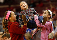 (left to right) Morgan Clate, 11, Petros Regules, 5, and Katerina Regules, 11, cheer to gain the attention of Ohio State mascot Brutus as he throws souvenirs into the crowd during the second half of the NCAA basketball game between the Ohio State Buckeyes and the Gonzaga Bulldogs at Value City Arena in Columbus, Ohio, on Sunday, Dec. 8, 2013. The Gonzaga Bulldogs defeated the Buckeyes 59-58. (Columbus Dispatch/Sam Greene)