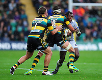 Semesa Rokoduguni of Bath Rugby takes on the Northampton Saints defence. Aviva Premiership match, between Northampton Saints and Bath Rugby on September 3, 2016 at Franklin's Gardens in Northampton, England. Photo by: Patrick Khachfe / Onside Images