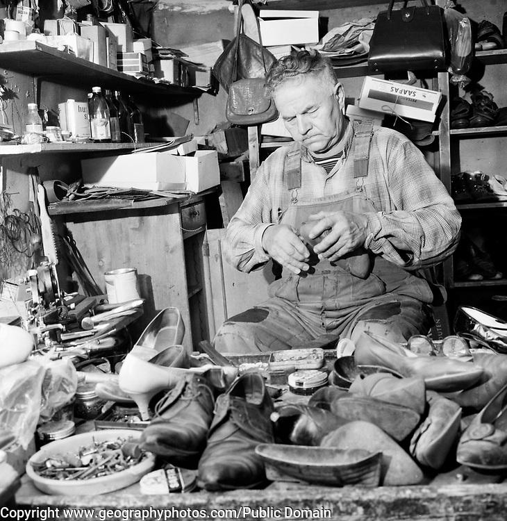 Cobbler at work in his workshop, Finland,  <br /> 1963
