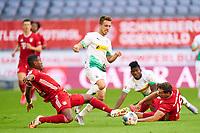13th June 2020, Allianz Erena, Munich, Germany; Bundesliga football, Bayern Munich versus Borussia Moenchengladbach;  Patrick HERRMANN, MG 7 skips the tackles from David ALABA, FCB and Leon GORETZKA, FCB