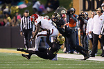 Kelvin Harmon (3) of the North Carolina State Wolfpack is tackled by Ja'Sir Taylor (24) and Demetrius Kemp (34) of the Wake Forest Demon Deacons during second half action at BB&T Field on November 18, 2017 in Winston-Salem, North Carolina.  The Demon Deacons defeated the Wolfpack 30-24.  (Brian Westerholt/Sports On Film)