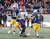 University at Albany Men's Lacrosse defeats Drexel 18-5 on Feb. 24 at Casey Stadium.  UAlbany midfielder Kyle McClancy (#40) takes a stick to the side of the helmet. (Photo by Bruce Dudek / Cal Sport Media/Eclipse Sportswire)