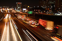Nightime traffic rolls into downtown Austin along Interstate 35 in a time-exposure from the highway overpass