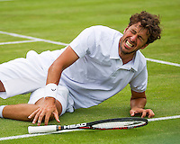 London, England, 30 june, 2016, Tennis, Wimbledon, Robin Haase (NED) falls to the grass in his match against Jack Sock (USA)<br /> Photo: Henk Koster/tennisimages.com