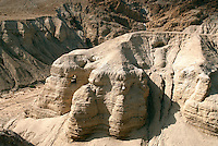 In the winter of 1946-47, a Palestinian boy named Muhammed edh-Dhib and his cousin discovered we know of today as the Dead Sea Scrolls in the caves of Qumran on the northwest shore of the Dead Sea in Israel. The Dead Sea Scrolls are a collection of just under 900 documents discovered between 1947 and 1956 in eleven caves in and around the ruins of the ancient settlement. Cave 4 is clearly visible on the center-left of this photograph.