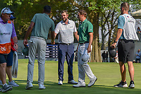 Tony Finau (USA), Marc Leishman (AUS), and Justin Thomas (USA) congratulate each other on 18 following round 4 of the World Golf Championships, Mexico, Club De Golf Chapultepec, Mexico City, Mexico. 3/4/2018.<br /> Picture: Golffile | Ken Murray<br /> <br /> <br /> All photo usage must carry mandatory copyright credit (&copy; Golffile | Ken Murray)