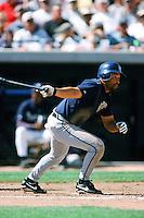 Fernando Vina of the Milwaukee Brewers bats during a 1999 Major League Baseball Spring Training game in Phoenix, Arizona. (Larry Goren/Four Seam Images)