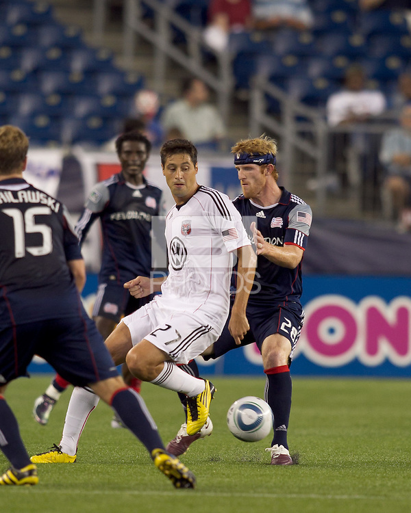 DC United midfielder Branko Boskovic (27) attempts to control the ball as New England Revolution defender Pat Phelan (28) pressures. The New England Revolution defeated DC United, 1-0, at Gillette Stadium on August 7, 2010.