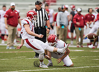 Hawgs Illustrated/BEN GOFF <br /> Chris Elser kicks an extra point as Chad Stephens holds in the fourth quarter Saturday, April 6, 2019, during the Arkansas Red-White game at Reynolds Razorback Stadium.