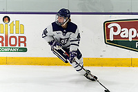 WORCESTER, MA - FEBRUARY 08: Emma Lange #16 of Holy Cross looks to pass during a game between Boston University and College of the Holy Cross at Hart Center Rink on February 08, 2020 in Worcester, Massachusetts.