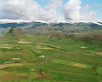 Rauðháls, Brekka, Ás og Kaldrananes. Búrfell í baksýn t.v.,.Dyrhólahreppur. /.Raudhals, Brekka, As and Kaldrananes. Mount Burfell left in background. Dyrholahreppur