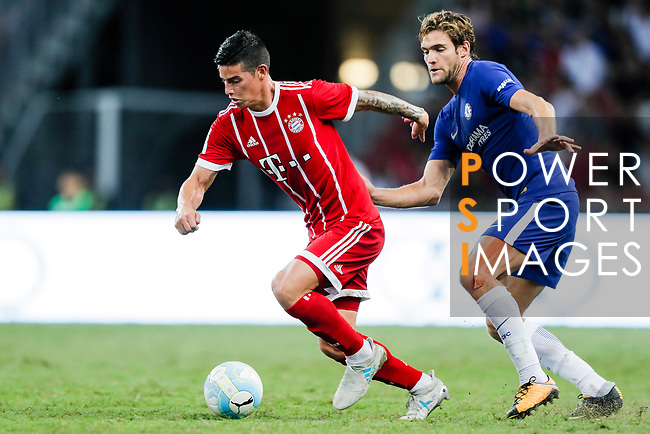 Bayern Munich Midfielder James Rodríguez (L) fights for the ball with Chelsea Defender Marcos Alonso (R) during the International Champions Cup match between Chelsea FC and FC Bayern Munich at National Stadium on July 25, 2017 in Singapore. Photo by Marcio Rodrigo Machado / Power Sport Images