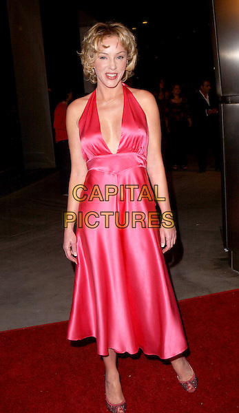 """JENNIFER McSHANE.The Sony Picture Classics' Premiere of """"William Shakespeare's The Merchant of Venice"""" which was part of the AFI Fest 2004 held at The Cinerama Dome in Hollywood, California .November 9th, 2004.full length, pink silk satin halterneck dress plunging neckline, cleavage.www.capitalpictures.com.sales@capitalpictures.com.©Debbie Van Story/Capital Pictures"""