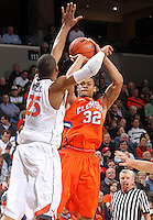 Clemson forward K.J. McDaniels (32) is defended by Virginia forward Akil Mitchell (25) as he shoots Thursday in Charlottesville, VA.