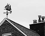 Black & White photo of a rooftop weathervane on Mt Washington in Pittsburgh.