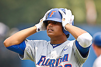 June 11, 2011:   Florida Gators inf/of Vickash Ramjit (30) looks in disbelief after he is called out running to first base during NCAA Gainesville Super Regional Game 2 action between Florida Gators and Mississippi State Bulldogs played at Alfred A. McKethan Stadium on the campus of Florida University in Gainesville, Florida.   Mississippi State defeated Florida 4-3.........