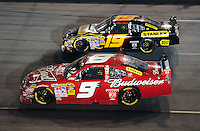 May 2, 2009; Richmond, VA, USA; NASCAR Sprint Cup Series driver Kasey Kahne (9) races alongside teammate Elliott Sadler (19) during the Russ Friedman 400 at the Richmond International Raceway. Mandatory Credit: Mark J. Rebilas-