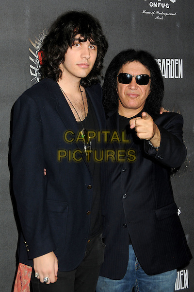 "NICK & GENE SIMMONS.""Guitar Hero: Warriors of Rock"" Launch Party held at Paramount Studios, Hollywood, California, USA..September 27th, 2010.half length suit jacket top black sunglasses shades hand finger arm pointing father dad son family .CAP/ADM/BP.©Byron Purvis/AdMedia/Capital Pictures."